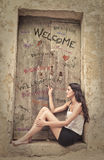 Writing welcome on a door Stock Image