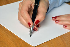 Writing on a white paper Royalty Free Stock Photography