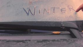 Writing winter on a car stock footage