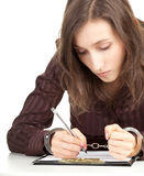 Writing woman with handcuffed hands Stock Photo