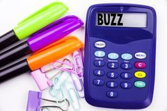 Writing word Buzz text in the office with surroundings such as marker, pen writing on calculator. Business concept for Buzz Word l. Lustration white background royalty free stock image