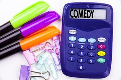 Writing word Comedy text in the office with surroundings such as marker, pen writing on calculator. Business concept for Stand Up. Comedy Microphone white Stock Photography