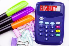 Writing word Eligibility text in the office with surroundings such as marker, pen writing on calculator. Business concept for Suit. Able Eligible Eligibility Stock Photos