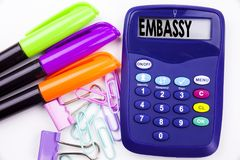 Writing word Embassy text in the office with surroundings such as marker, pen writing on calculator. Business concept for Tourist. Visa Application white Stock Image