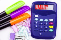 Writing word Liability text in the office with surroundings such as marker, pen writing on calculator. Business concept for Accoun. Tability Legal Blame Risk Royalty Free Stock Photos