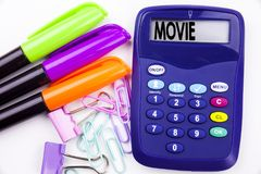 Writing word Movie text in the office with surroundings such as marker, pen writing on calculator. Business concept for Entertainm Royalty Free Stock Images