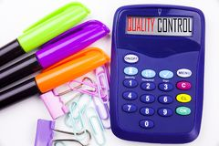 Writing word Quality Control text in the office with surroundings such as marker, pen writing on calculator Business concept for P stock images