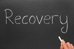 Writing the word recovery on a blackboard. Royalty Free Stock Photo