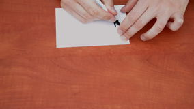 Writing words Thank you. Interlocutor writes note with the words Thank you in the office stock video footage