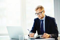 Writing working plan Royalty Free Stock Photo