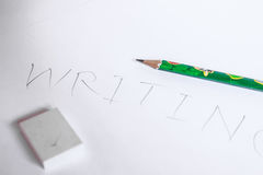The writing. The writting word from the pencil and eraser Royalty Free Stock Image