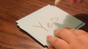 Writing yes. Young women`s hand writing the word yes on a white card stock video
