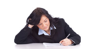Writing young businesswoman Stock Photo