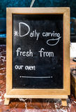 Writings on a blackboard with wooden frame that indicates the fo royalty free stock image