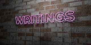 WRITINGS - Glowing Neon Sign on stonework wall - 3D rendered royalty free stock illustration Royalty Free Stock Photo