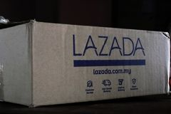 Writings On A Lazada Shipping Cardboard Box stock photography