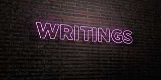 WRITINGS -Realistic Neon Sign on Brick Wall background - 3D rendered royalty free stock image Stock Photos