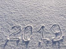 2019. Writings on the snow. Happy new year. Beautiful cold sunny. Winter day. The game of light and shadow royalty free stock images