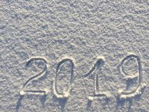 2019. Writings on the snow. Happy new year. Beautiful cold sunny. Winter day. The game of light and shadow royalty free stock photos