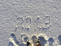 2019. Writings on the snow. Happy new year. Beautiful cold sunny. Winter day. The game of light and shadow stock images