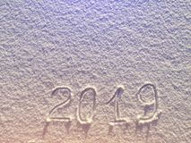 2019. Writings on the snow. Happy new year. Beautiful cold sunny. Winter day. The game of light and shadow stock photo