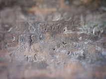 Writings on stone royalty free stock photography