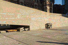 Writings on the Wall. TORONTO – NOVEMBER 13 - Writings on the wall at Nathan Phillips Square by people protesting against Mayor Rob Ford November 13, 2013 Royalty Free Stock Photos