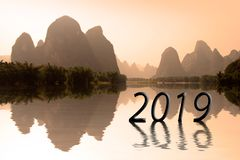 2019 written in asian landscape at sunset. New year greetings royalty free stock photo