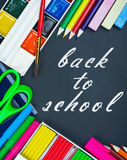 Written on the blackboard back to school and supplies Stock Image