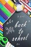 Written on the blackboard back to school Stock Photos