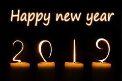 2019 written with candle flames on black. Background royalty free stock images