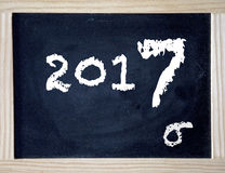 2017 written with chalk on black board. The numbers 2017 written with chalk on black board Royalty Free Stock Images
