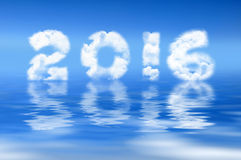 2016 written with clouds. Water reflection Stock Image