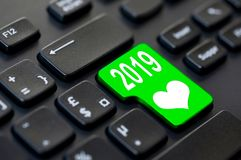 2019 written on a computer keyboard and a heart. Year 2019 written on a computer keyboard and a heart royalty free stock photography