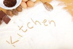 Written in flour - kitchen Stock Image