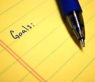Written Goals. Goals written on yellow paper with blue pen Stock Images