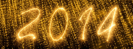 2014 written in golden sparkling letters royalty free stock photos