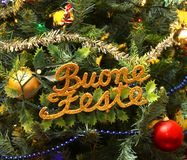 Written happy holidays in Italian in the  Christmas tree Royalty Free Stock Photography