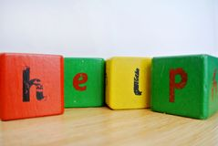 Written help. The written help with colored cubes Royalty Free Stock Photo