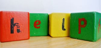 Written help. The written help with colored cubes Stock Images