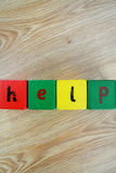 Written help. The written help in the wood cube Stock Photography