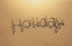 Written holiday on the sand. Beach Royalty Free Stock Images