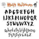 Written in ink vector alphabet. Unique font for the holiday Halloween Stock Image