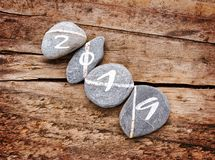 2019 written on a lign of stones on wooden background. 2019 written on a lign of stones on a wooden background royalty free stock photo