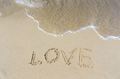 Written LOVE on sand beach Royalty Free Stock Photos