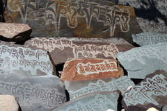 written mantra on buddhist mani stones Royalty Free Stock Image