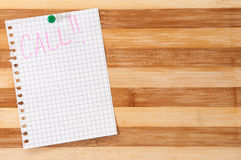Written message call on the wooden board as background Royalty Free Stock Image