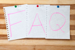 Written message FAQ on the wooden board as background Royalty Free Stock Photography