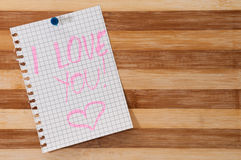 Written message I love you on the wooden board as background Stock Photography