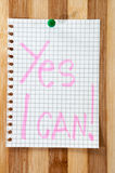 Written message Yes I can on the wooden board as background Stock Photos